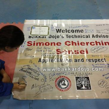 signing poster for sensei