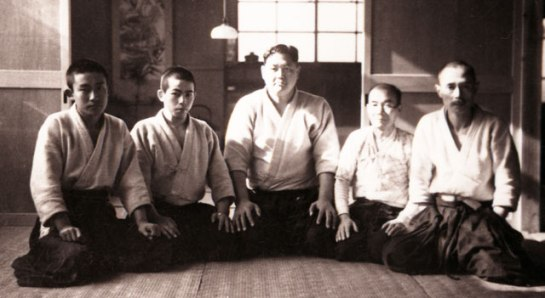 The sumotori Tenryu (centre) became students of Morihei Ueshiba after being defeated by him
